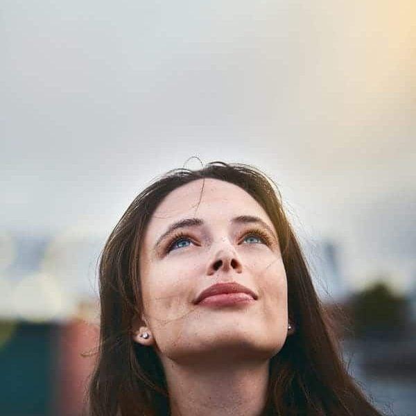 hopeful woman looking to sky